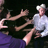 Neil McCoy greets his fans along a barricade at his Gladewater Rodeo performance Tuesday. Matula photo.