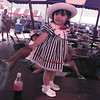 Victoria Lopez 16 months old says c'mon dad lets boogie to her father Raul at Alley Fest while listning to the music of dr.Benjamin &Van go Sunday afternoon.