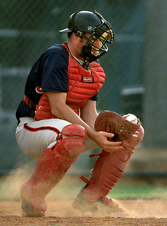 Longview AL's #28 manages to keep a hold of a dirtball Tuesday night against E Texas. Matula photo.