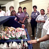 Betty Edwards, right the food service supervisor for Gladewater ISD, shows a class one of her mobile food carts, with chips, peanuts, and other small items, during a tour of her kitchen by Lynn Schroff's work simplification class, Lynn is the food service supervisor at Mesguite ISD., during the Texas School Food Service Association Workshop at the Gladewater High School Wednesday afternoon in Gladerwater. Kevin Green