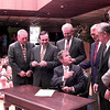 Gov. Geroge W. Bush hands A.W. (Dub) Riter Jr., a University of Texas System regent, a pen after signing a downward expansion bill, Friday afternoon at The University of Texas at Tyler. Kevin Green