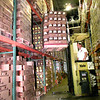 Steve Barnes, lowers a pallet of Blue Bell Ice Cream, in the refrigerated holding facility on Eastman Road in Longview Friday morning. Kevin Green