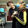 Carol Ray helps Sesha Wallace the ten year old daughter of Cindy Wallace try on her scuba gear during the lock-in at Pine Tree Intermidiate school Friday night. Kevin Green