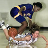LeTourneau's #12 is thrown to the floor and stomped on by Jarvis' #21 in the first half of The Lady Jackets' conference win Tuesday night. Matula photo.