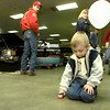 J.P. Woods, 3, could care less about the classic cars around him when he's got a beaty in his hand. He finds a spot at the ET Street Machine Show at the fairgrounds Exhibit Hall Saturday. Matula photo.