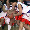 KC's #30, right, and #32, left, fight it out with Trinity Valley's #13 for a tie in the 2nd half of the Lady Rangers' region loss Tuesday night. Matula photo.