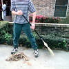 Misdemeanor violator sweeps leaves at the Harvey Johnson center recently as part of his punishment meted out by the LISD Teen Court program. Matula photo.