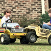 Eric Ross left,4 and his brother Christopher Ross 7 , the sons of Ronny and Lisa Ross, have and accident in their front yard Monday afternoon off Graystone in Longview. They were off for spring break. Kevin Green