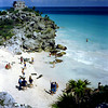 The beach at Tulum with a watch tower on the far cliff. The sandy area was used as a harbor by the Mayans. Tlulum was their busiest port. Matula photo.