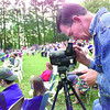 Paul Autrey a member of Fellowship Baptist Church  of Longview, video tapes the Easter sunrise service Sunday morning at Teague Park in Longview. Obie Le Blanc