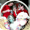 Laurel LaRue, left, helps Easter Seals child representative Aaron Daividson, 7, and his mom Marie with loading up Easter baskets for auction at Longview mall this weekend. Easter Seals says it will ahve about 120 baskets for auction. Matula photo.