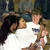 """Shannon Greenhouse, left, and Tracey Pepper, right, laugh and clap as Kim Chatman gives her coach the """"thumbs up"""" during ceremonies honoring the Ladt Jackets at Solheim Arena Tuesday. Matula photo."""