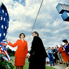 Texas First Lady Laura Bush, left, and Marshall mayor Audrey Kariel prepare to remove the bunting from Marshall Pottery's new historical marker Thursday. The pottery shop, started in 1895, became the city's 100th historical landmark. Matula photo.