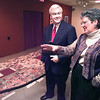 Hull Barbee Cairman and CEO of Longview National Bank talks with Pat Johnson the artist for the Feats of Clay project Tuesday morning at the Longview Art Museum. Kevin Green