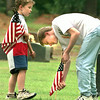 Logan Crenshaw, 6, left, the son of Donnie and Kathy Crenshaw of Glenwood holds flags as his cousin Scott Hudson the 14 year old son of Robert and Patti Thompson of Tyler puts flags at the graves of veterans Saturday morning at Memory Park Cementary on East US 80 in Longview. Kevin Green