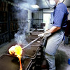 Tony Pierce pours brass into a mold at his foundry outside of New Diana. Kevin Green