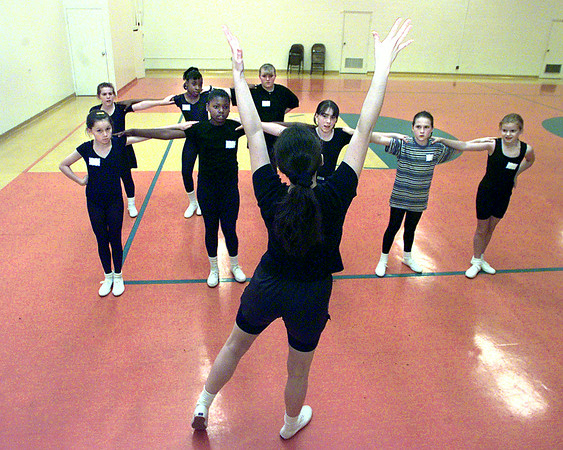 Dance instructor Nicole Treadway shows a routine to her young proteges Saturday at Bethel Temple. Matula photo.la