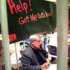 Howard W. Rosser, the executive director for the East Texas Tourism Association, trys to raise money for his bail at the MDA lock-up Thursday morning at Longview Mall.