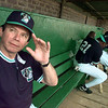 Tyler Wildcatters manager Darrell Evans waves to a frind at Mike Carter Field during media day Tuesday. Matula photo.