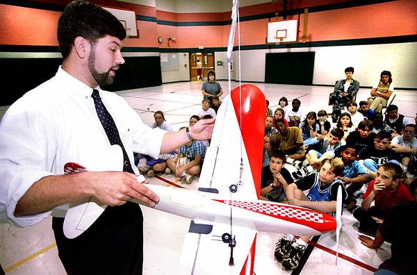 Andrew Visser a senior flight student at LeTourneau University teaches some fifth grade students about flying at the Kilgore Intermediate School in Kilgore Thursday afternoon. Kevin Green