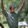 Tiger Woods reacts to the crowd after finishing the 18th hole Friday afternoon at the Byron Nelson Classic. Kevin Green