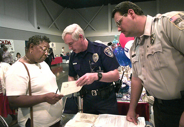 Doris Wilson, left, of Marshall, gets a little information on community policing from Longview Police Department P.A.R. officer for beat 50, middle and the community police officer from White Oak Shawn Whisenhunt, at the senior fair at Maude Cobb last week. Kevin Green