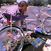 Micheal Starling, of Longview, checks one of the low-rider bicycle that was on display at the Cino de Mayo festival at Maude Cobb in Longview Saturday afternoon. Kevin Green