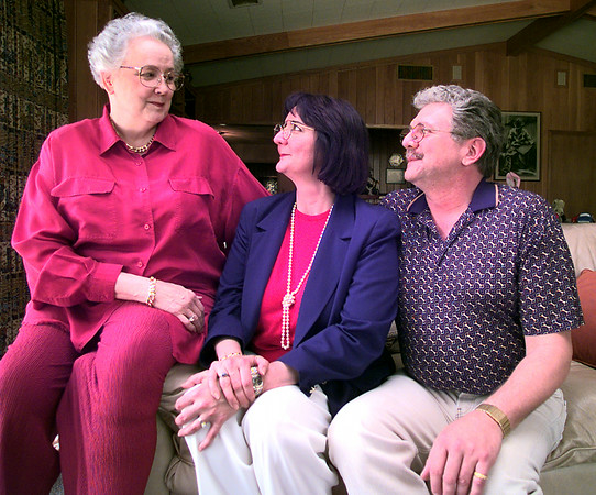 Irene Cook, left, sits on the sofa with her daughter Terry Slater of Longview and son Paul Cook of Tyler. Kevin Green