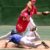 #50 Chad Hensley of West Rusk High School misses the catch as Casey Heineman from Tatum slides in safe during the east vs. west game at Driller Park in Kilgore Saturday afternoon. Kevin Green