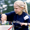 Marcy Roe, 10- year daughter of Harry and Penny Roe watches as she fills the bucket with water during a water relay at the Christian Heritage School's enbd of school field day at McWhorter Park in Longview Friday afternoon. Kevin Green