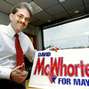 John Green in his office holding a McWhorter sign after a very big victory in the election. Kevin Green