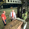 04/16/98--Carthage Public Workas Director Bob Mihlhauser, left, and city manager Charles Thomas look over one of the first bales of soon-to-be recycled packing materials to come off the new city Materials Reclamation Center Thursday. Matula photo.