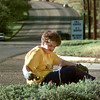 Date:   4/2/98---June Strohsahl, of Longview, pulls weeds in the 1000 BLK. of Pine Tree Rd. at Louis Morgan Drug, Thursday afternoon in Longview. kevin green
