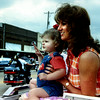 04/25/98--Former Miss Wildflower 1980 Reginia Walker and her 20 month-old daughter Morgan watch the annual wildflower parade in Hughes Springs Saturday. Bill Thompson photo.