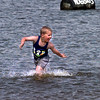 Date:   4/13/98---Blake Price,6, of Gladewater, looks at his parents while running in the water Monday afternoon at Gladewater Lake in Gladewater. Kevin green