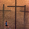 04/08/98--Mackenzie Robertson, 8, runs past the shadows of several crosses placed in front of Highland Park Baptist Church in Kilgore recently during a game of tag with her friends. Matula photo.