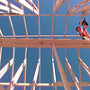 Date:   4/1/98---Clark Moore, with Salinas Design & Construction of McAllen, TX., general contractor is Oscar Salinas, frames wood trusses Wednesday afternoon at  Homewood Suites on Spur 63 in Longview. Kevin green