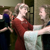 "04/04/98--Kena Hedrick, in red, fluffs up the sleeves of Rachel Smith as the Kilgore College Chamber Singers prepare to perform at the American Heart Assn of Longview's annual ""Heart Ball"" Saturday night in Maude Cobb. The chorale group dressed in Medieval costumes in keeping with the motif of the occassion. Matula photo."