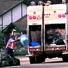 Date:   4/16/98--Lanzell Williams, with the dept. of sanitation fro the Longview, picks up blue recycle bags with a two compartment trash truck Thursday morning off of Gilmer Rd. in Longveiw. kevin green