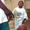 Date:   4/23/98---Kendal Green, 7, right, looks up at Demetrius Robbinson,  a staff member at the Boys and Girls Club of Gregg County, Thursday afternoon while shooting hoops at the center during the opening to kids. Kevin green