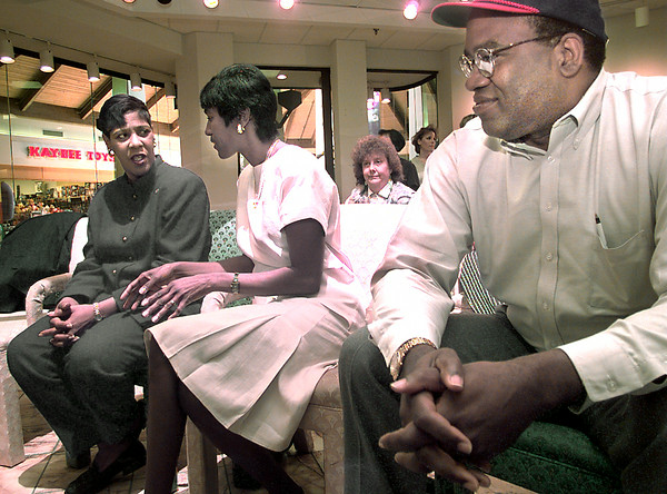 Date:   4/23/98---Kay Chappell, left, visits with Regina Mason, center of San Jose California, while Stan Mason, right, looks on during a press conference Tursday morning at Longview Mall. kevin green