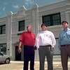 Date:   4/16/98--Dennis Bowles and sons stand in front of a building in the 400 blk of N. Green St., Thursday afternoon in lOngivew., Kevin green