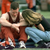 04/17/98--White Oak sprinter Chris Walker gets a little consolation from friend Amanda Carr after the District 16-3A track meet at Bear Stadium in Gladewater Friday evening. Matula photo.