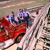 Date:   4/7/98--- Longview Firefighters Scott Lake, left, Aaron Deary, center and LT. Mark Wittig, right, sit atop LFD's ladder 8 truck at station 8 Tuesday afternoon, the 1974 ladder truck is set to be retired if bond passes. Kevin green