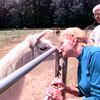Date:   4/24/98----Celia, left, 3 years greets Dolores with a kiss at the gate as Donley looks on. Kevin green