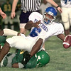 Date:   8/21/98----Spring Hill's # 6 drops the ball while getting tackled during a scrimmage Friday night against Dallas Madison at Panther Stadium in Longview. Kevin Green