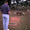 Date:   7/17/97---Eddie Sammons Jr. takes a moment to visit his uncle's grave Friday morning at Elderville Cemetery during the cemetery reunion.  Jessica Williamson