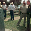 Date:   8/29/98---U.S. Border Patrol Agent Dan M Harris Jr. visits with a relative after a ceremony of the memorial of his great grandad Texas Ranger Dan McDuffie Saturday afternoon in Gladewater. Kevin green