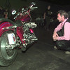 8/29/98---Cy Costner gets a closer look at one of the Harley Davidson motorcycles on display Saturday at the Biker Ball. Bahram Mark Sobhani