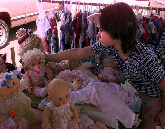 Date:   7/19/97---Amanda Pearce, 10, daughter of Allen and Penny Pearce of Gladewater, tries to decide what to spend her birthday money on at the Longview Jaycees Trade Days Saturday afternoon at the Longview Fairgrounds.  Jessica Williamson